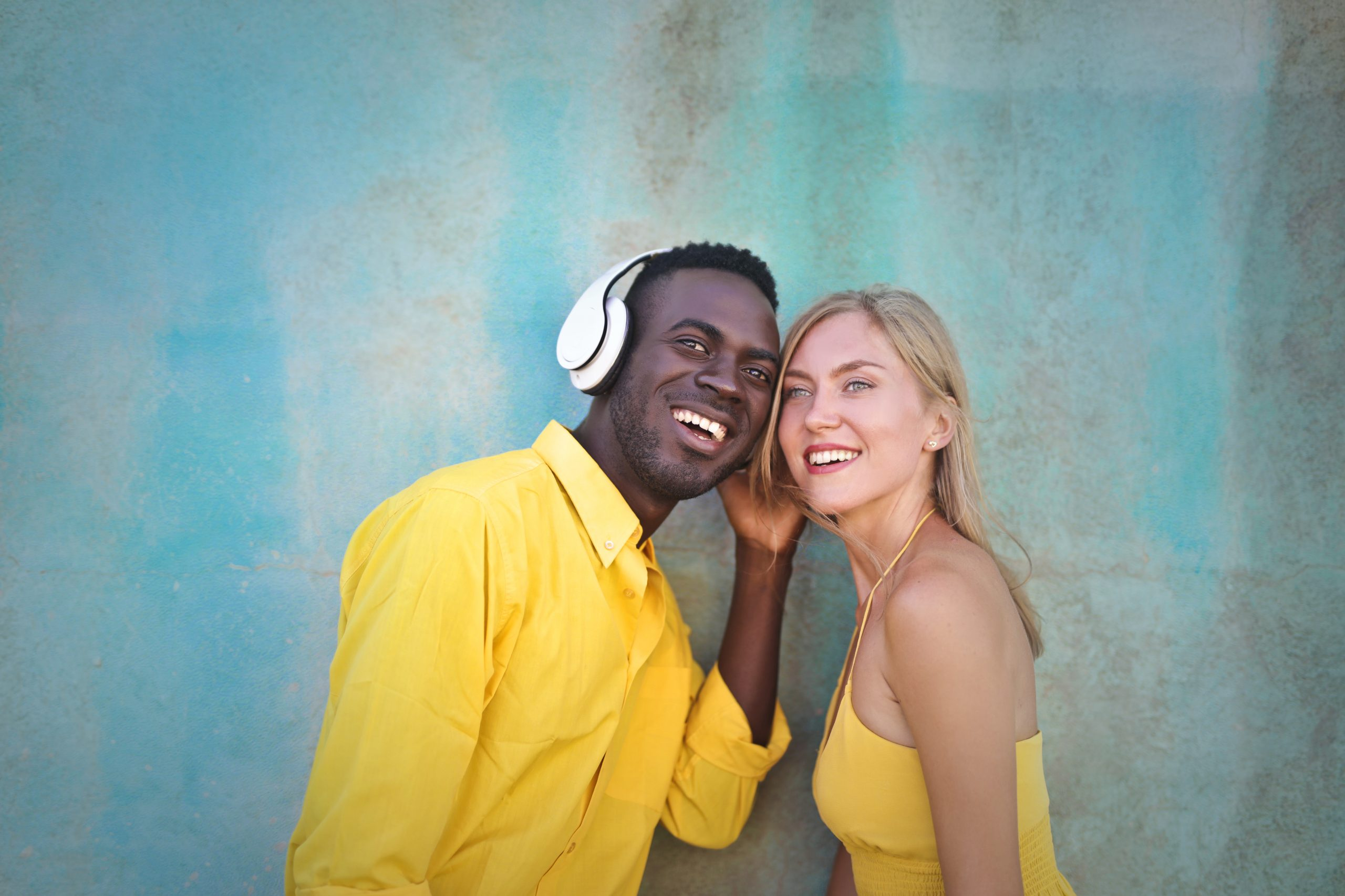 Cheerful diverse couple smiling and looking away