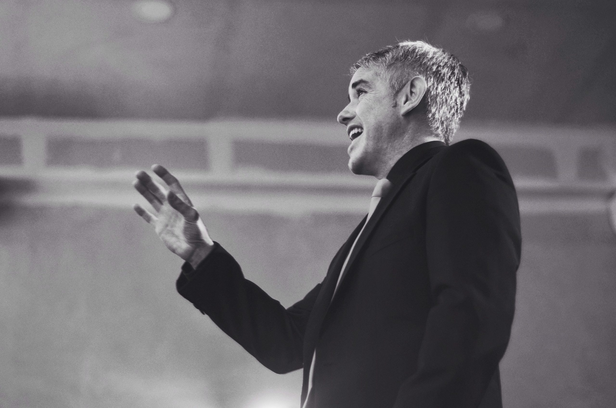 grayscale photography of man singing