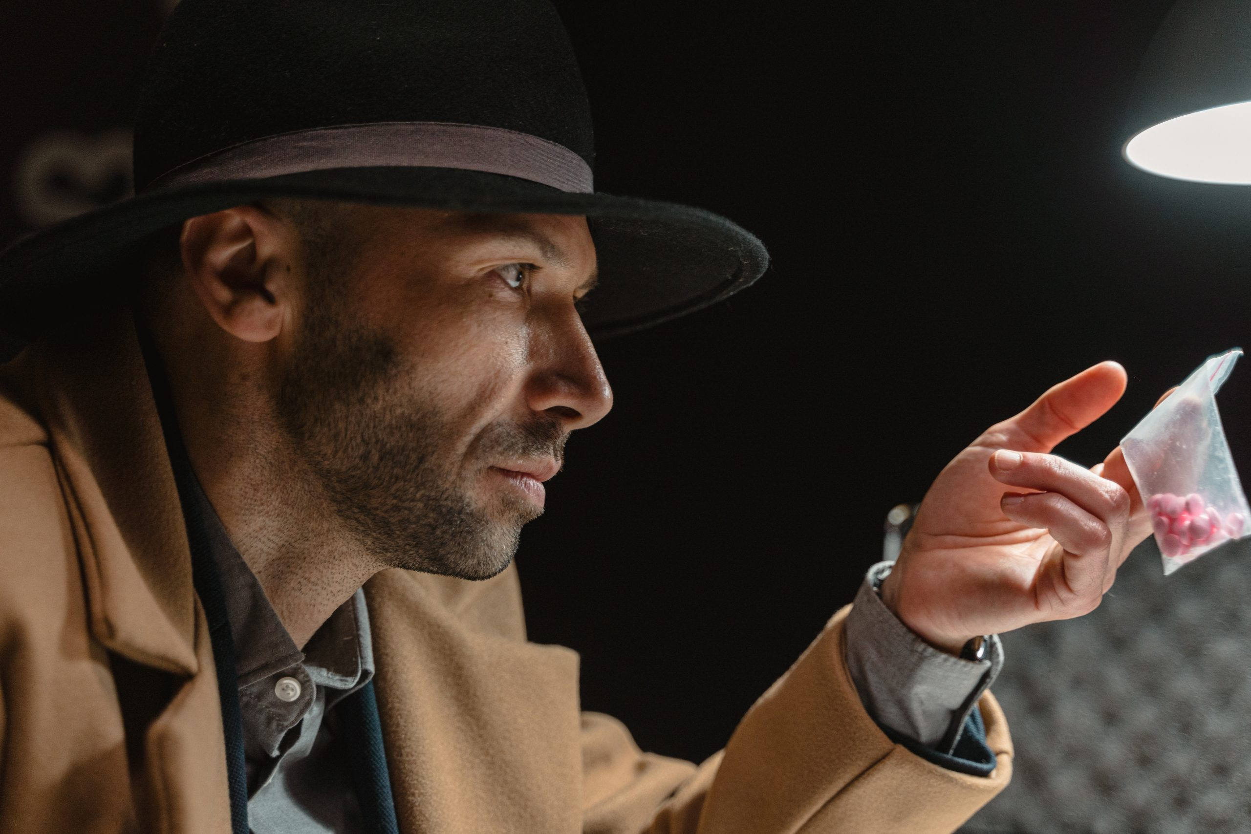 Man in brown coat and black hat