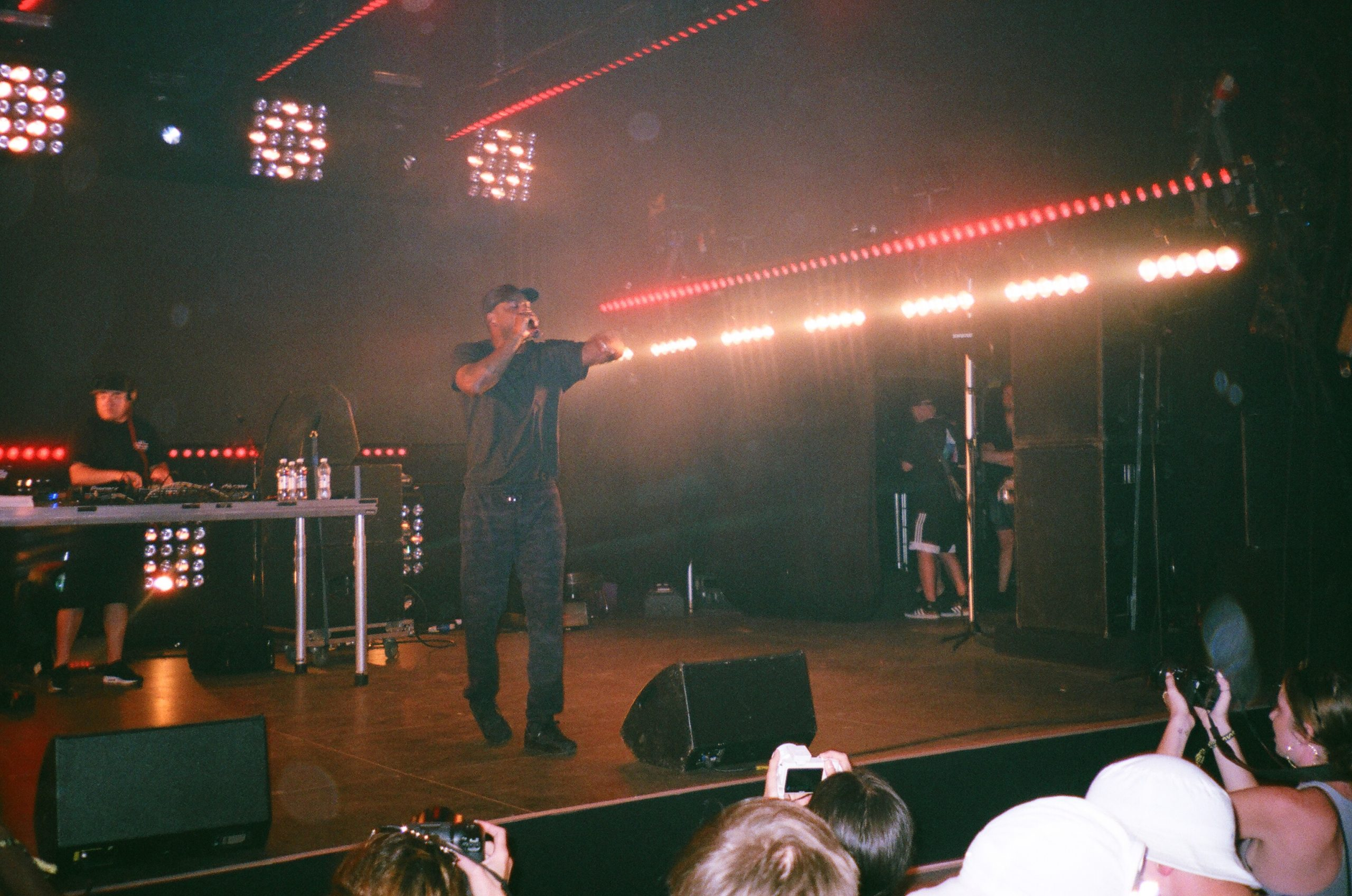 Man standing on stage facing people