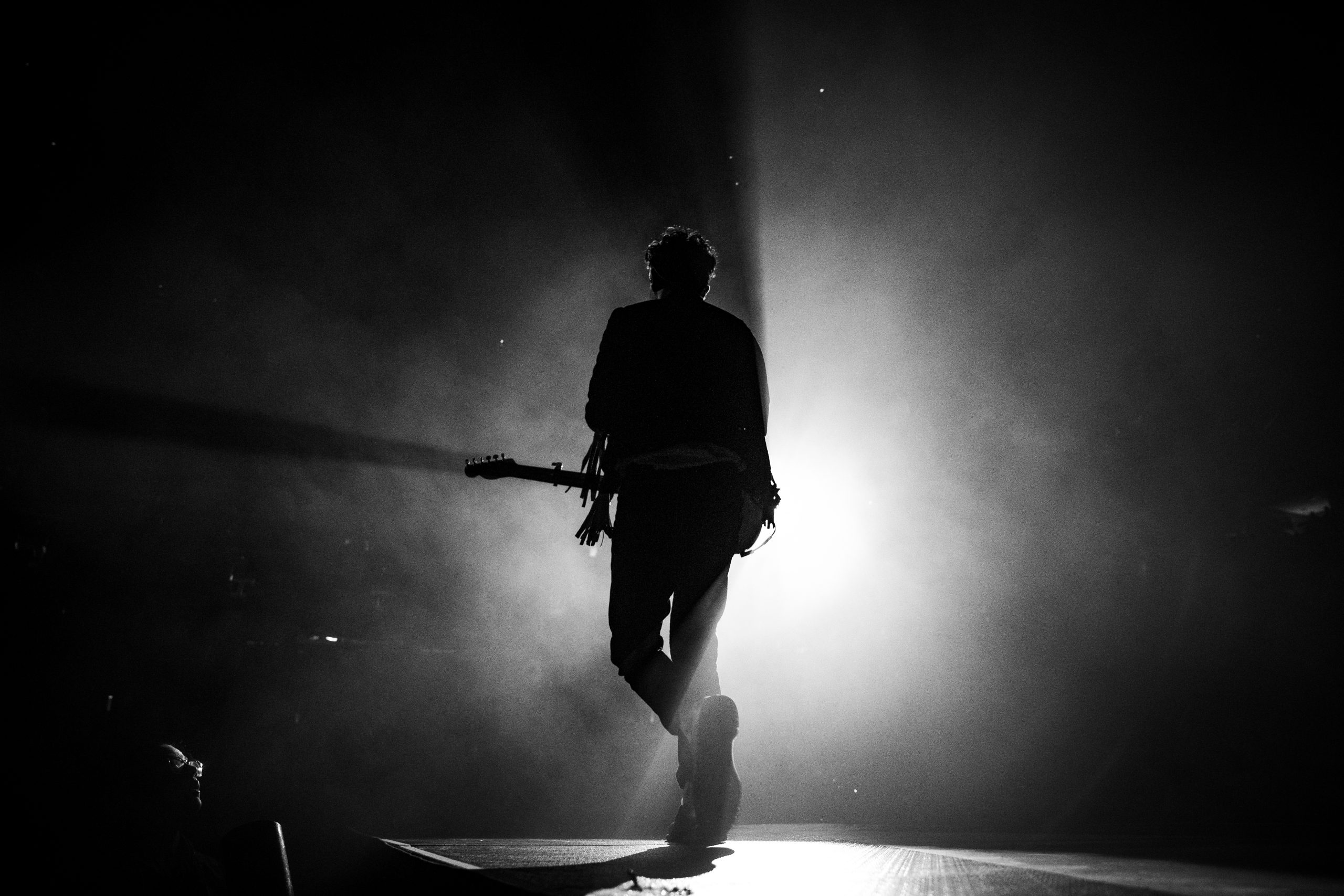 Silhouette photo of man singing on stage