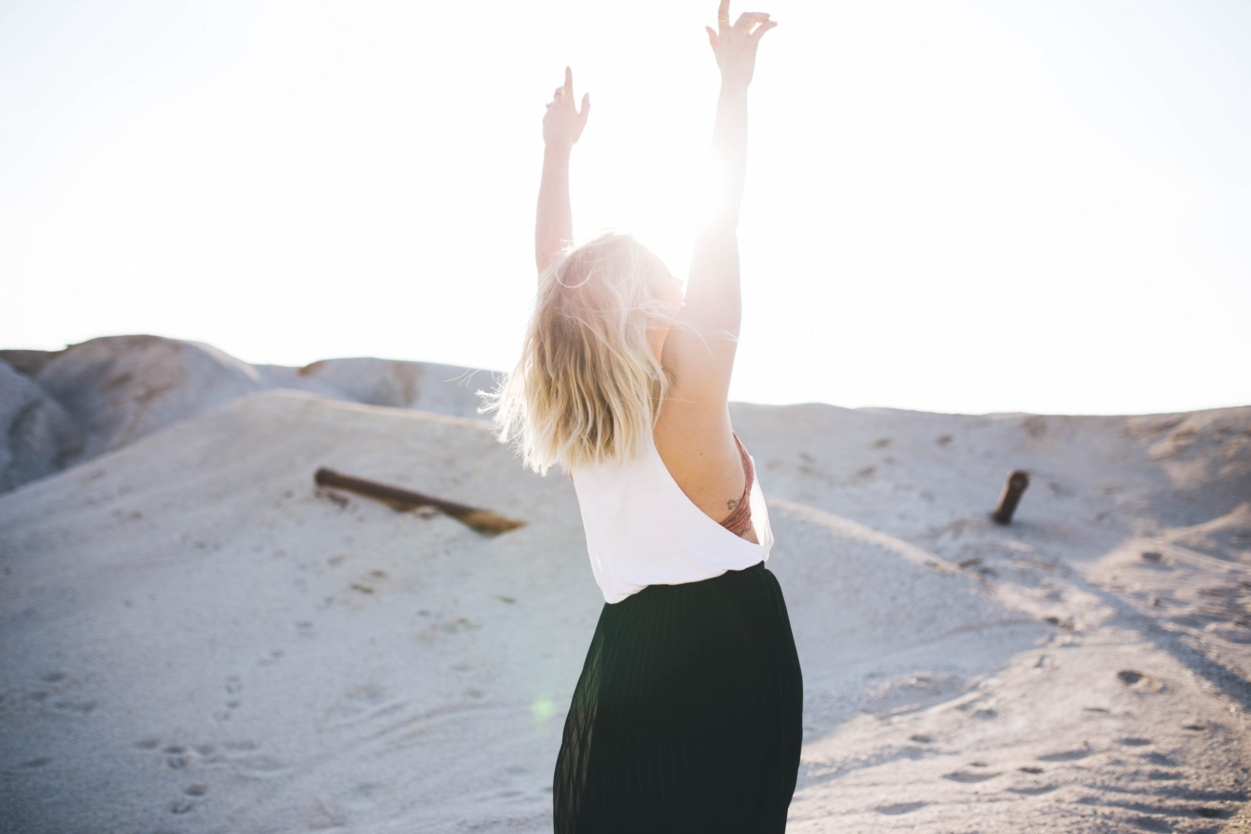 Woman lifting up her hands