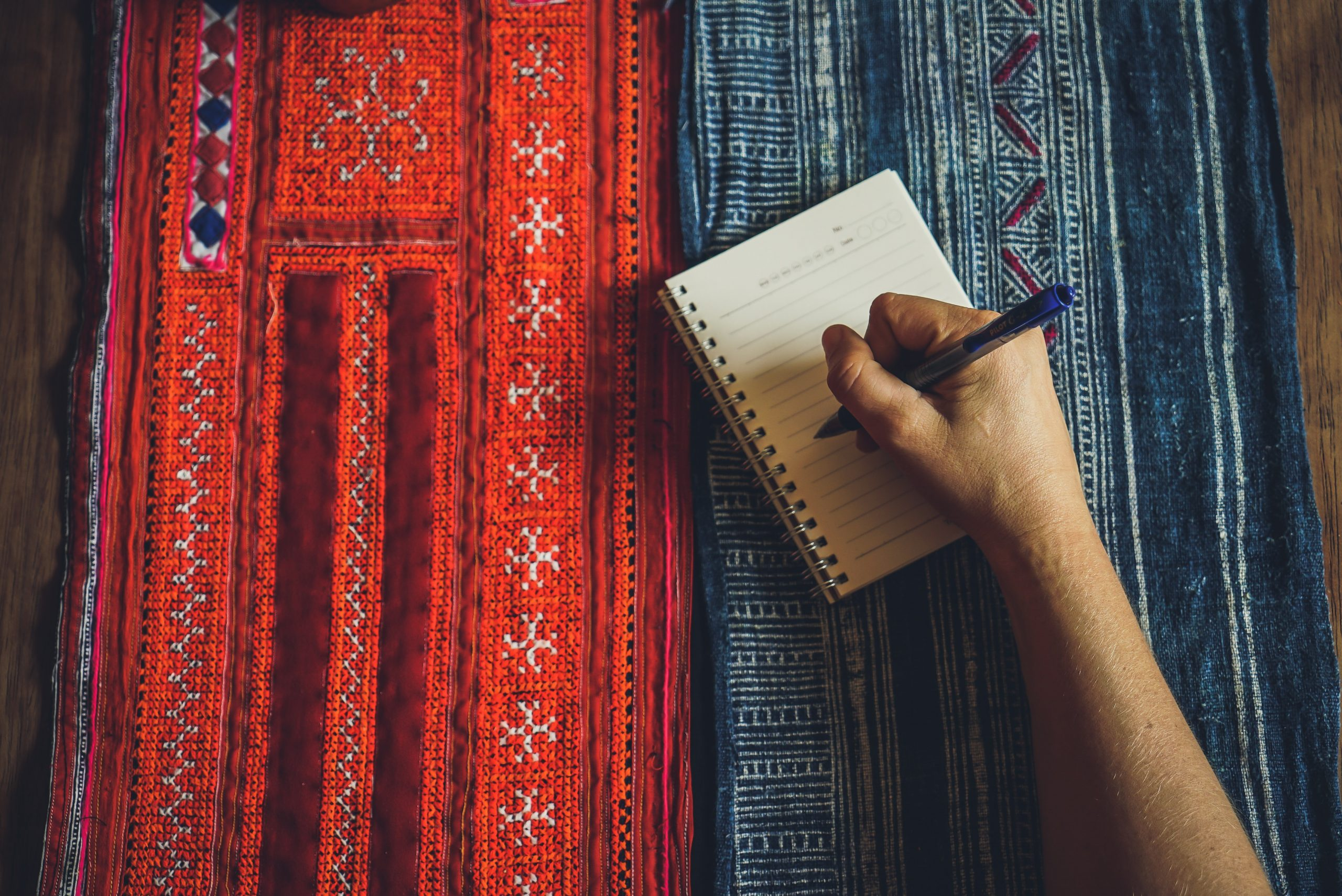 writing notes in a notebook.
