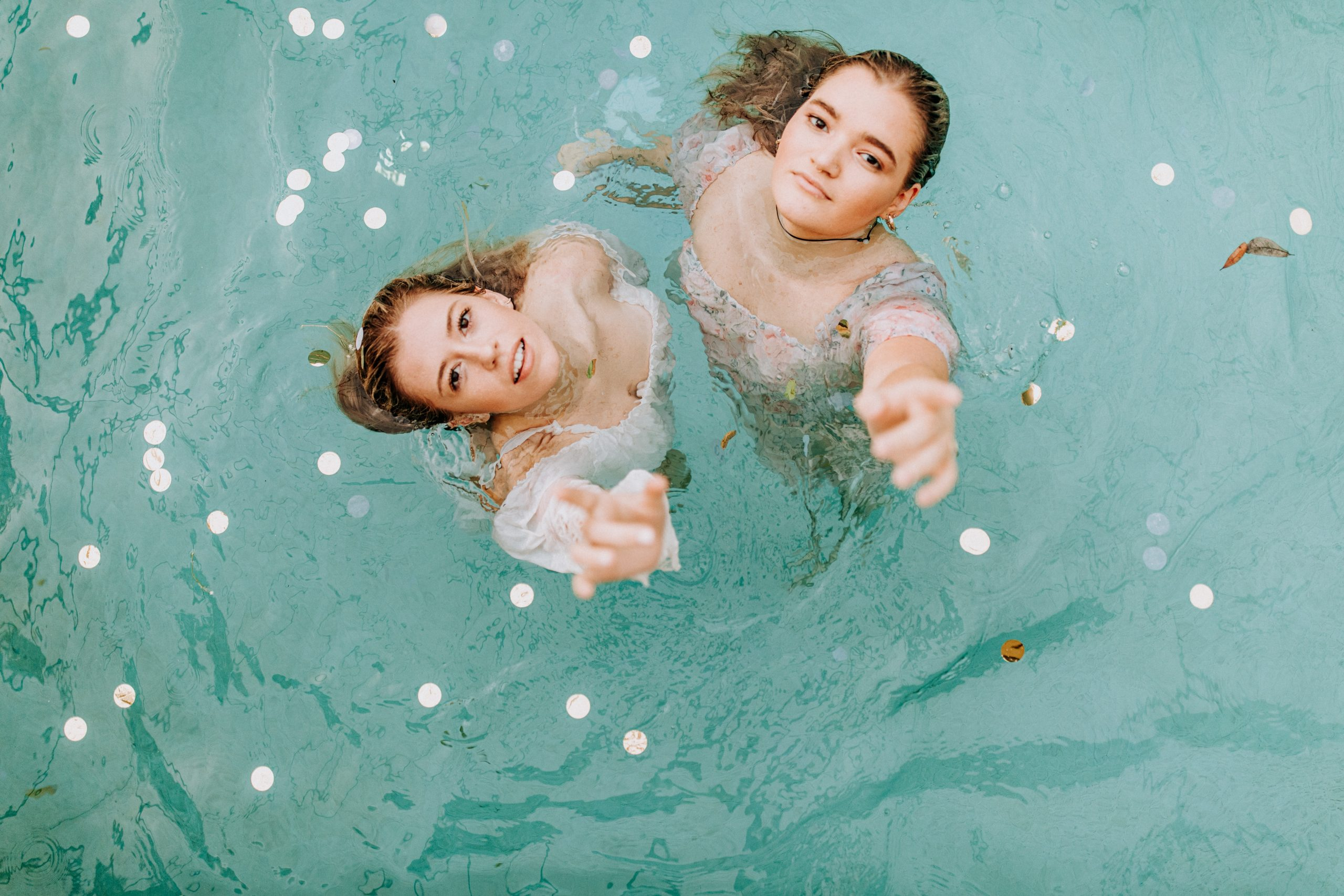 2 girls in water during daytime