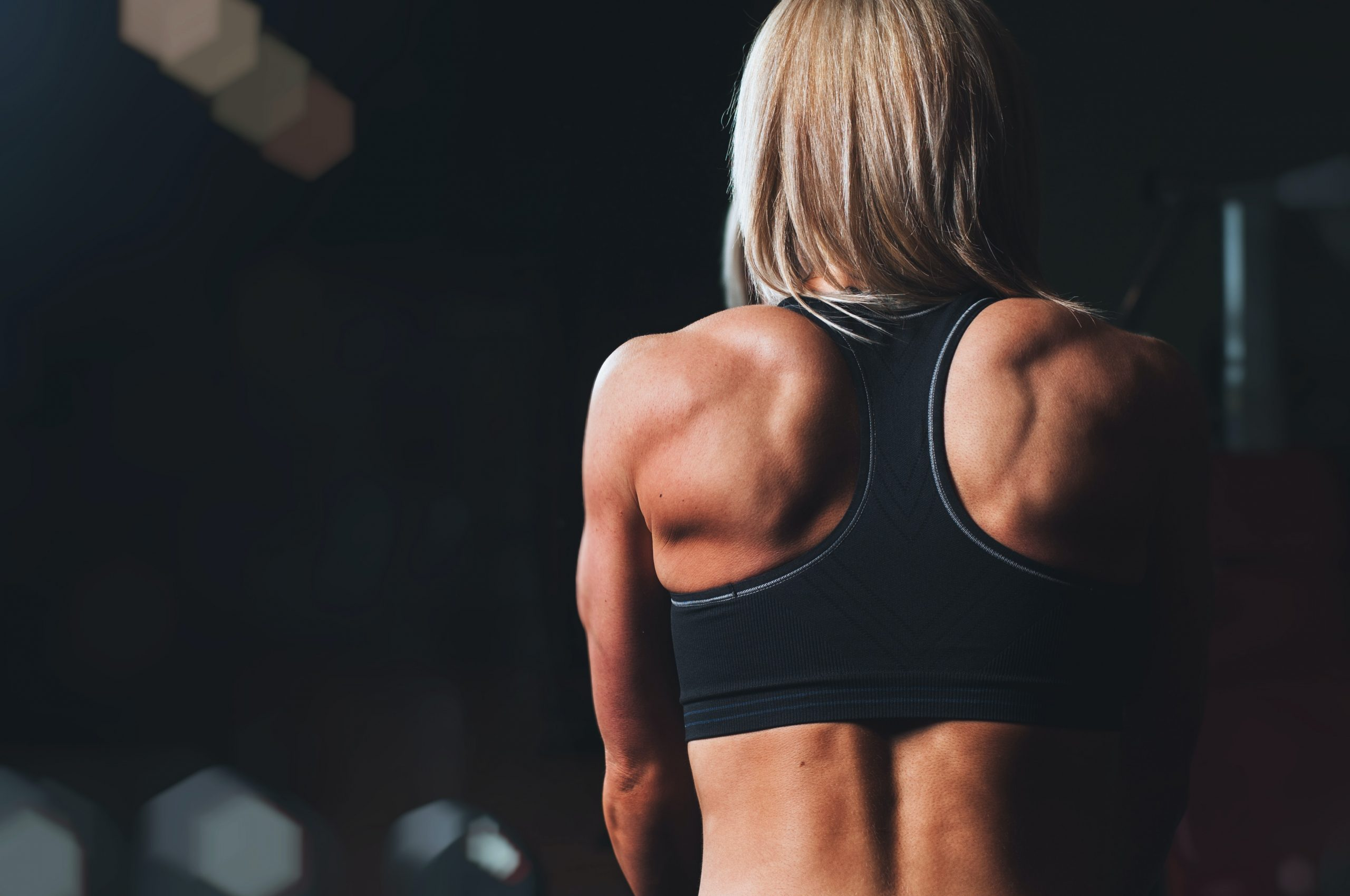 A blonde woman working out at the gym