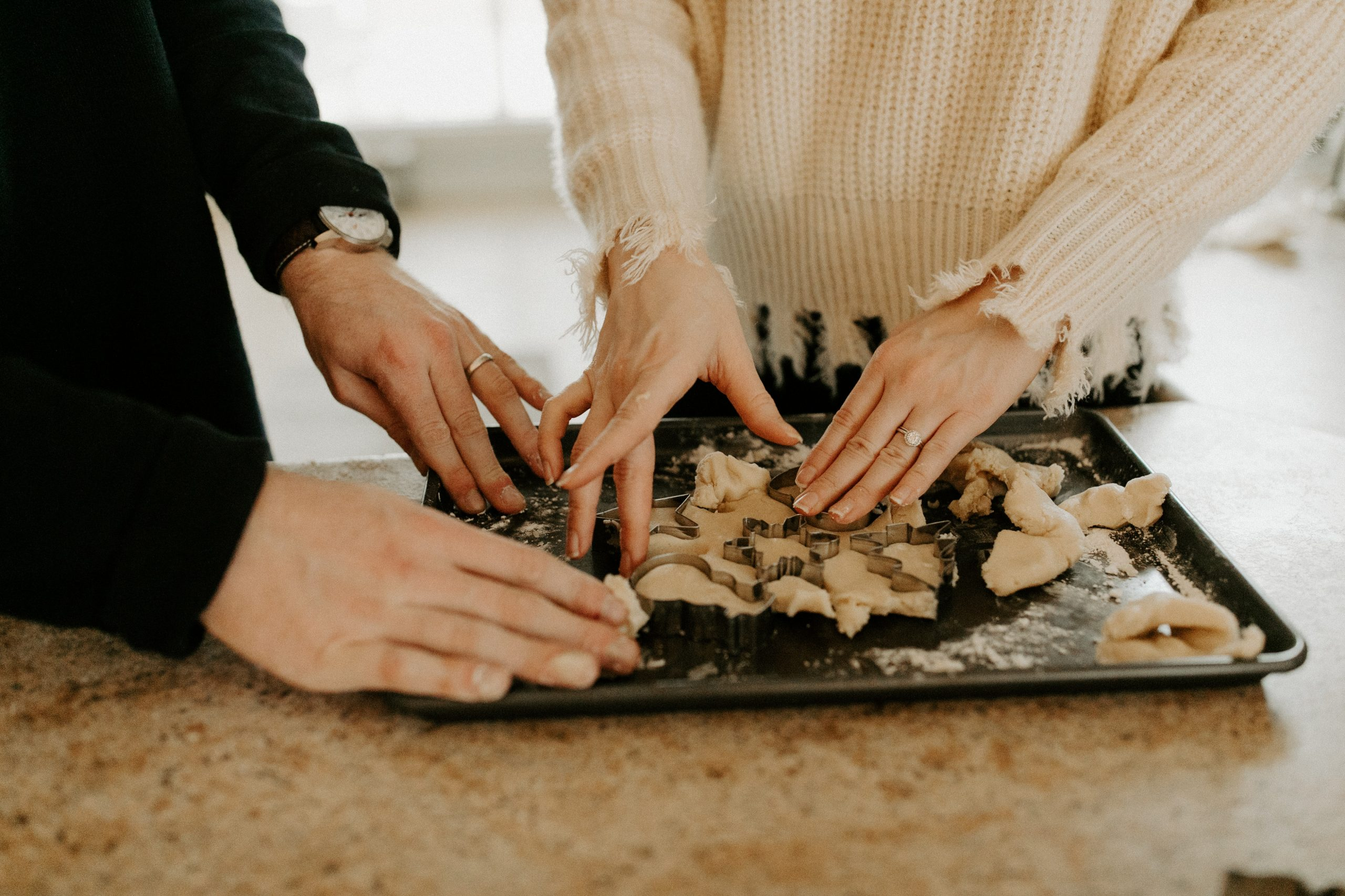 couple hands baking christmas holiday cookies