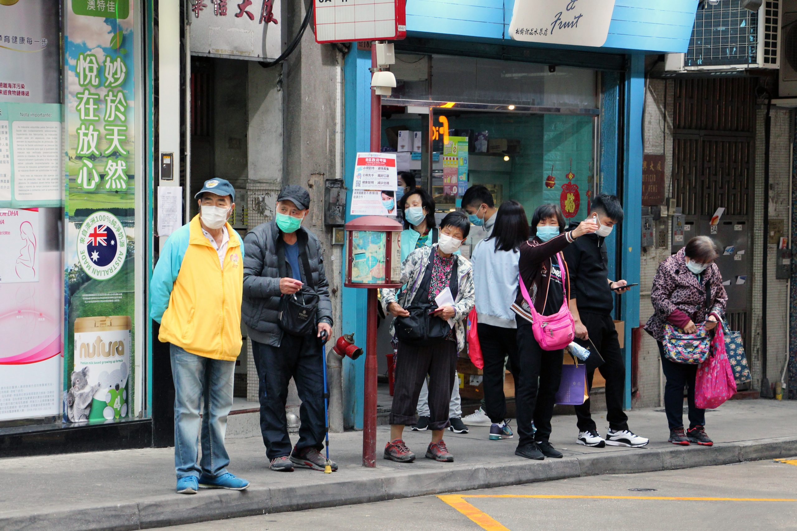 Elderlies wearing face masks at a Bus stop in Macau, China in the surroundings of the public hospital. (RW)
