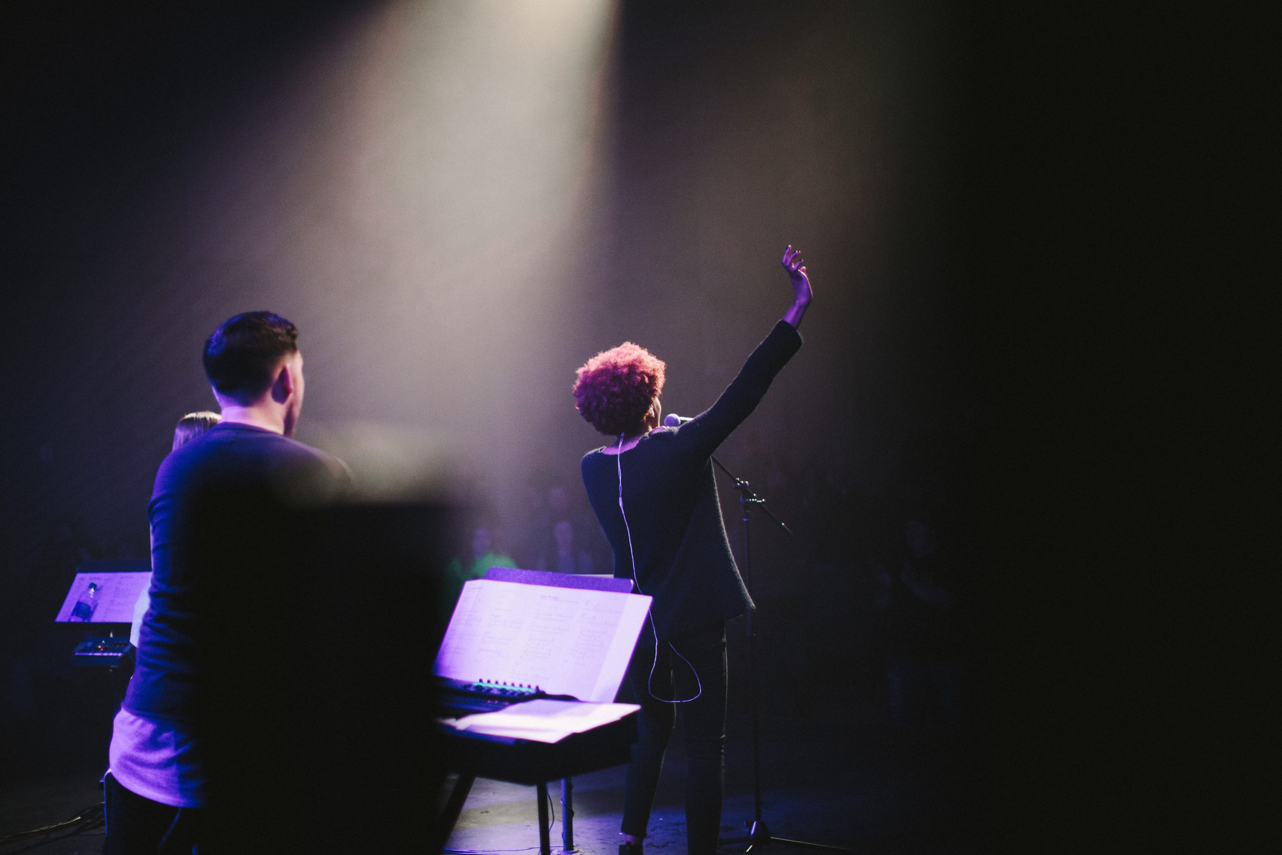 Female vocalist waving