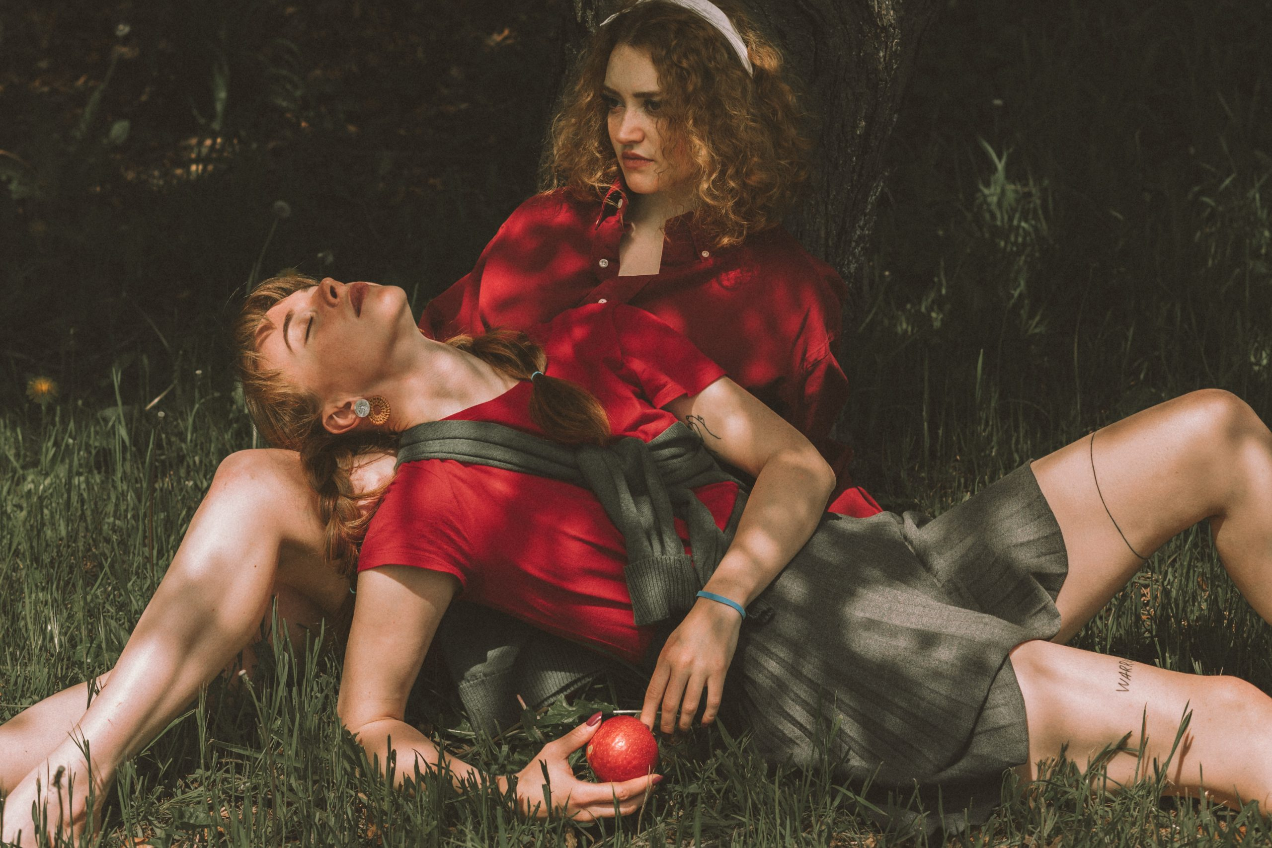 Relaxed couple lying on grass
