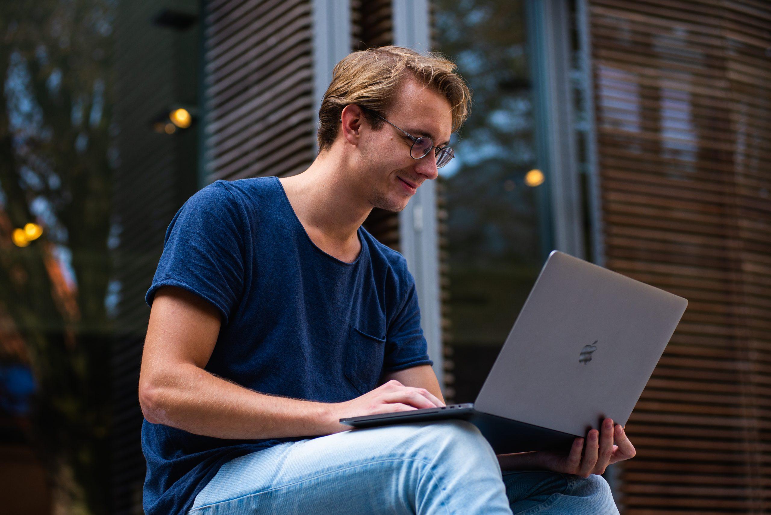 Selective focus photo of man using laptop
