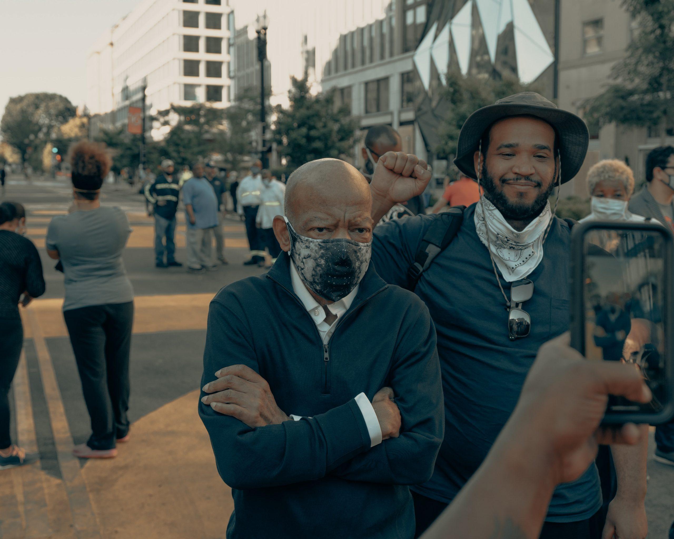 U.S. Representative John Lewis poses for a photo at Black Lives Matter plaza in Washington DC (IG: @clay.banks)