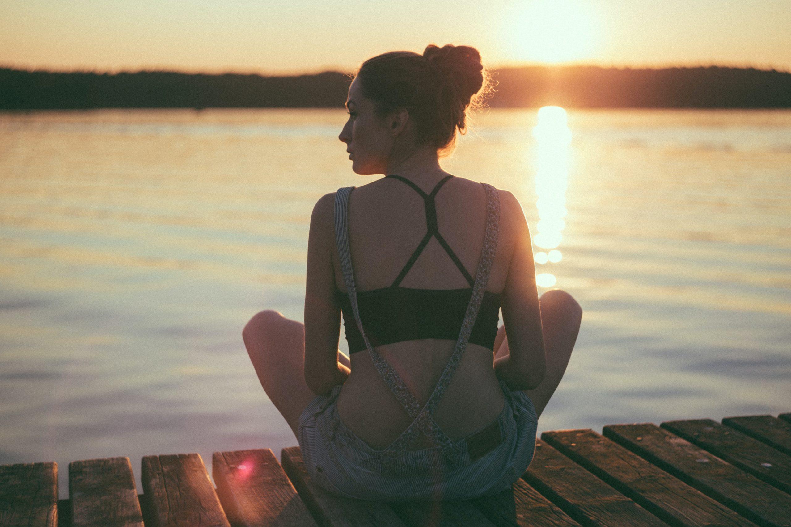 Woman on dock sunset