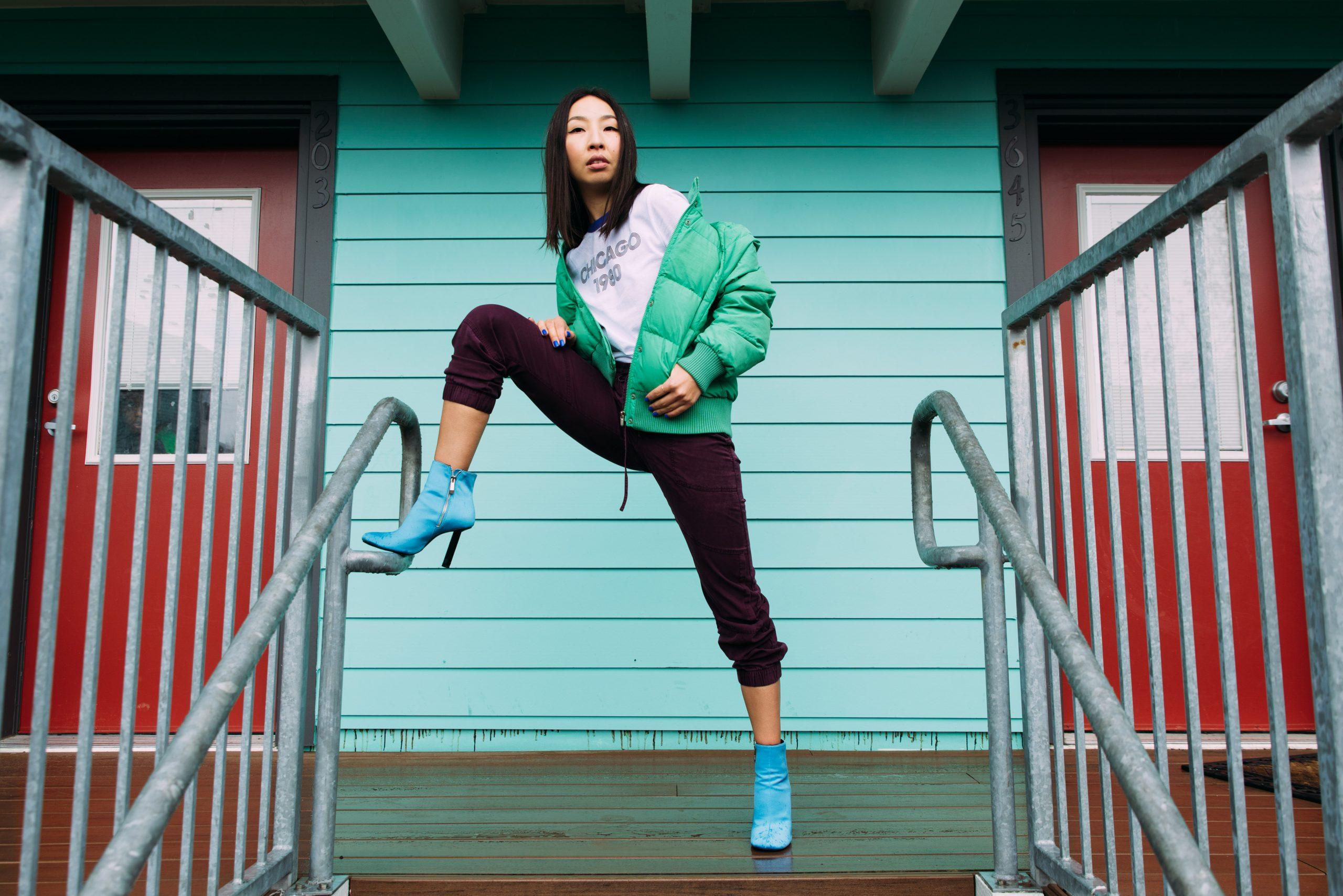 Woman wearing green jacket