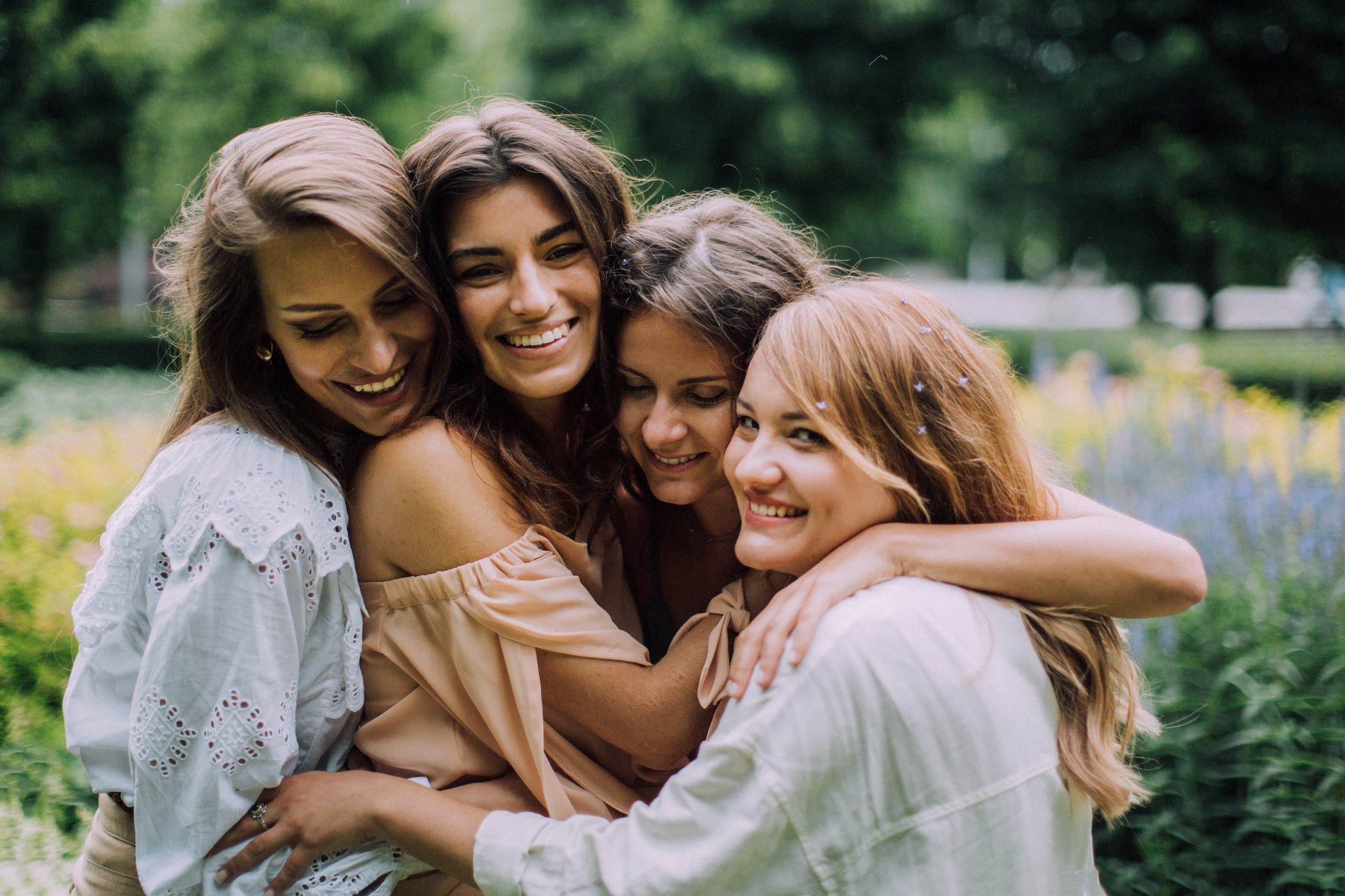 Women hugging and smiling